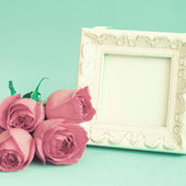 Vintage frame and roses — Stock Photo