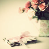 Pink roses and letters with ribbon — Stock Photo
