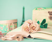 Vintage Roses on book — Stock Photo