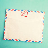 Heart clip and vintage envelope — Stock Photo