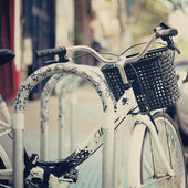 Bicycle parked in the city — Stock Photo