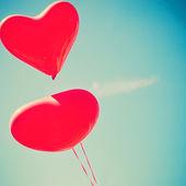 Retro love balloons on sky — Stockfoto