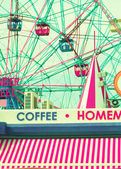 Cafe with Ferris wheel on background — Stock Photo