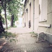 Bench near building — Stock Photo
