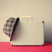 Vintage suitcase and hat — Stok fotoğraf
