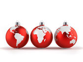 Christmas ornaments with world maps — Stock Photo
