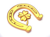 Horseshoes and clover with four leaf  — Stock Photo