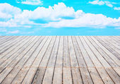 Wooden floor and clouds — Stock Photo