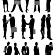 Businesswoman and businessman silhouettes — Stock Vector #51123031