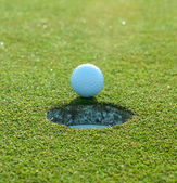 Golf Ball About to Drop in Hole — Stock Photo