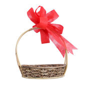 Empty wicker basket with red bow — Photo