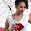 Asian woman with an umbrella posing in studio — Stock Video #50636595