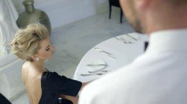 Beautiful blonde woman making order in a luxury restaurant — Stock Video