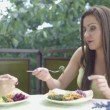Shot of a pretty young girl friends enjoying dinner outside in a garden. — Stock Video #51289747