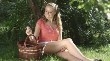 Beautiful Smiling Woman Relaxing in the Orchard With Basket of Apples. — Stock Video