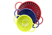 Set of three colorful colanders — Stock Photo
