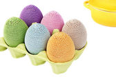 Colorful crocheted eggs in a box — Stock Photo