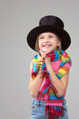 Smiling six year old girl in a black hat — Stock Photo