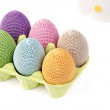 Colorful crocheted eggs in a box — Stock Photo #51137383
