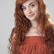 Portrait of a smiling red haired girl — Stock Photo #51395513
