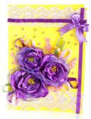 Bunch of purple flowers on yellow  — Zdjęcie stockowe