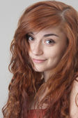 Portrait of a smiling red haired girl — Stock Photo