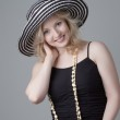 Young beautiful smiling  blonde woman in a hat  and a black dres — Stock Photo #51781803