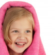 Smiling little girl wrapped in a pink towel — Stock Photo #51788335