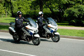 Two police officers riding motorcycles — Stock Photo