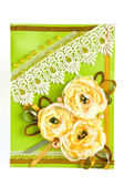 Bunch of yellow flowers on light green — Stock Photo