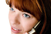 Beautiful red haired girl speking on cell phone face close-up — Stock Photo