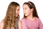 Two girls in the age of ten and eleven talking — Stock Photo