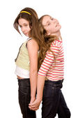 Two girls in the age of ten and eleven standing and embracing ha — Photo