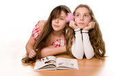 Two girls in the age of ten and eleven reading book  — Stock Photo