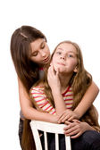 Two girls in the age of ten and eleven embracing hands — Stock Photo