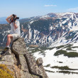 Photographer makes photo in the mountains — Stock Photo #50881969