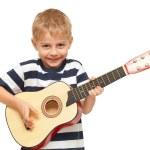 Amazing boy playing guitar — Stock Photo #50882071