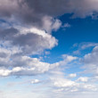 Fluffy clouds in blue sky. — 图库照片 #50884741