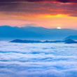 Sunrise over the sea of fog in the mountains — Stock Photo #50886093