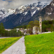 Spring landscape with church in the Swiss Alps. — Stock Photo #50886303