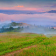 Foggy morning in the mountain village. — Stock Photo