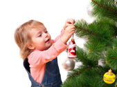Cute little girl decorates the Christmas tree — Stock Photo
