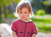 Little girl looking sadly — Stock Photo