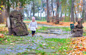 Girl walking in the autumn park — Stock Photo