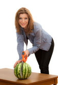 Woman sawing the watermelon — Stock Photo