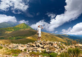 Thirsty hiker in the mountains — Stock Photo