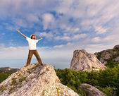 Hiker at the top of a rock — Stock Photo