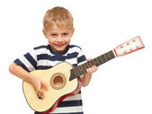 Amazing boy playing guitar — Stock Photo