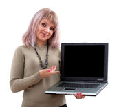 Attractive girl displaying a laptop — Stock Photo
