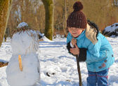 Young girl with snowmen — Stock Photo
